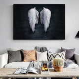 Large Angel wIngs above living room sofa