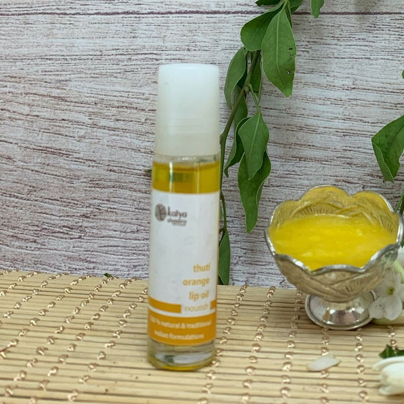 thuti orange - lip oil to treat dry chapped lips