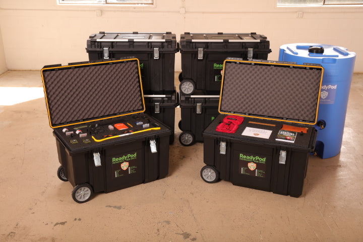 Several large ReadyPod™ trunks with telescoping handles and large wheels that make them easy to move