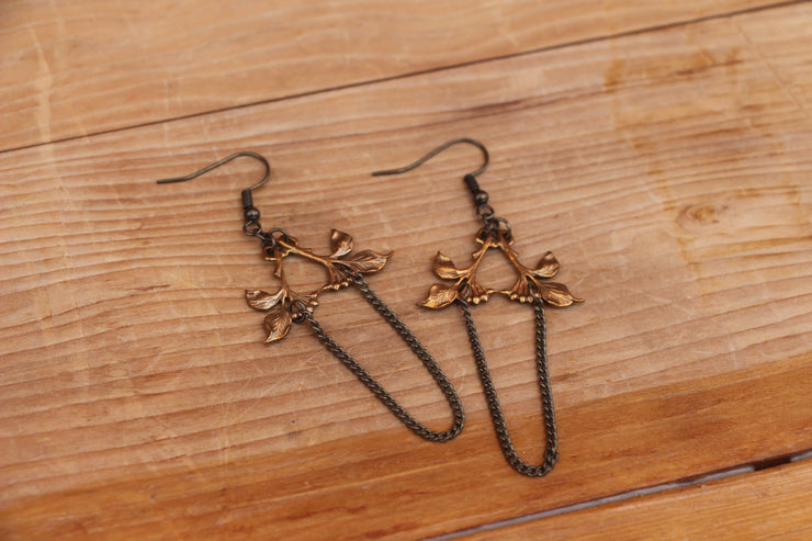 Brass flora, chandelier style chain dangle earrings.