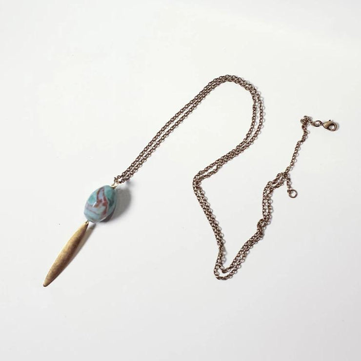 Stone and brass long pendant necklace in teal