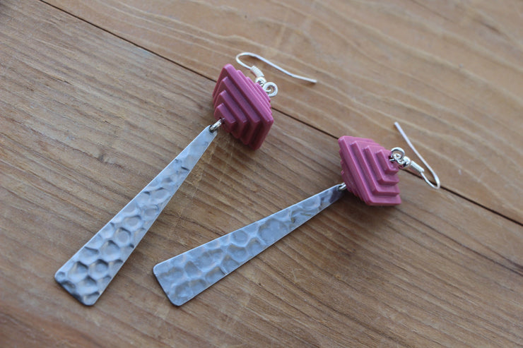 Elongated silver triangles and funky pink retro statement earrings