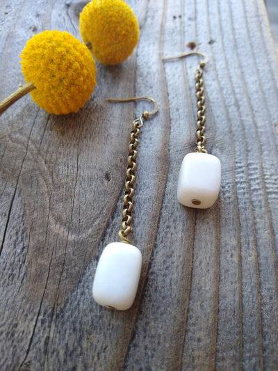 Chunky brass chain and white cube shaped stone bead dangle drop earrings.