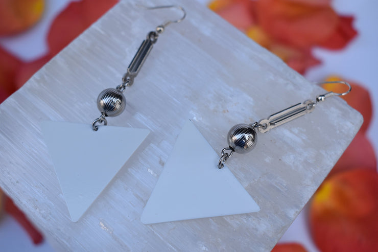 White and silver link dangle statement earrings