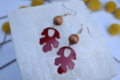 Red enameled leaf and wood bead earrings. Mid length leaf and stone earrings