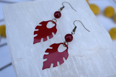 Red enameled leaf and red glass beads. Mid length leaf and glass earrings