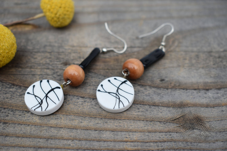Black and white funky vintage paint splatter disks and wood and glass beads, retro, funky fashion earrings