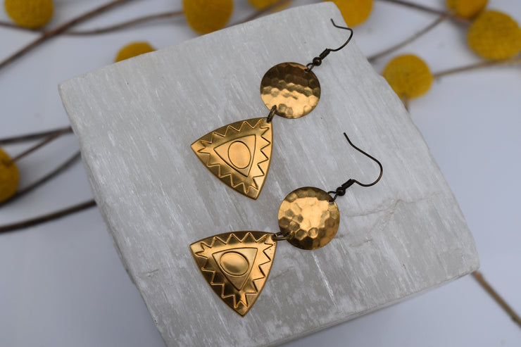 Brass geometric triangle and disc hinged statement earrings.