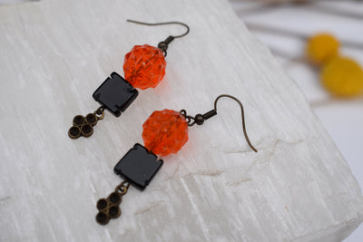 Orange and black dangle earrings
