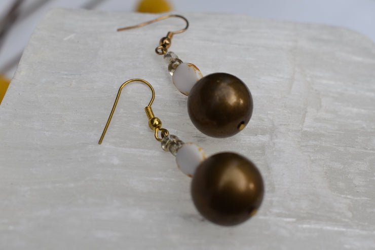 Dainty gold and white bobble dangle earrings.