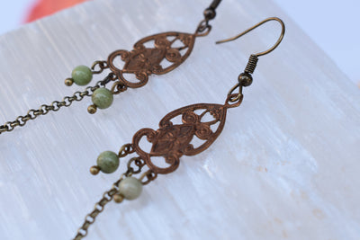 beautiful patterned vintage copper stamping's and chain dangle earrings with soft green stones