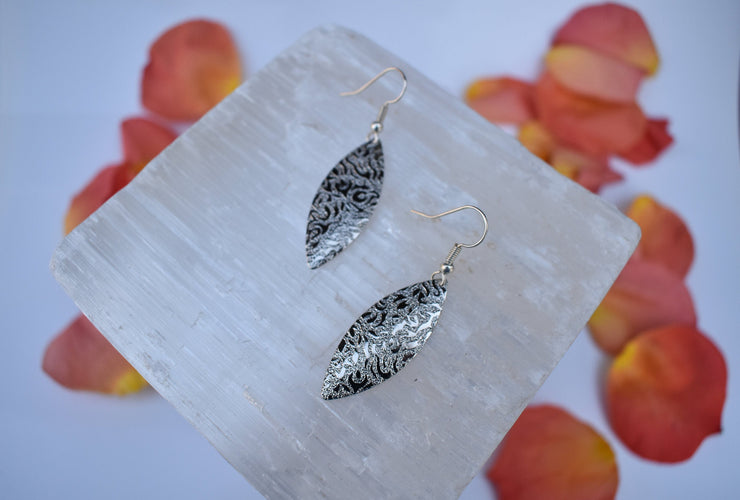 simple silver textured earrings with patterned relief