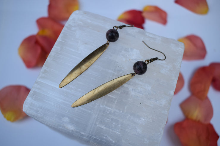 brass dagger and black and purple stone earrings