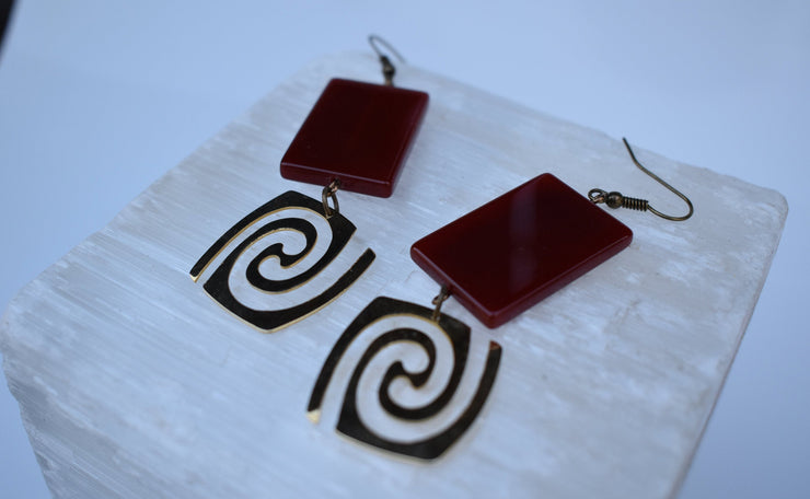 Drama and Swirl gold and Carnelian disco earrings.