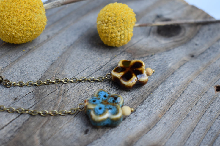 miss matched ceramic flower dangle earrings with long brass chain, shoulder duster statement earrings.