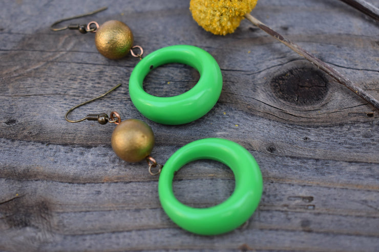 Lime green hoop and bronze boho dangle earrings.