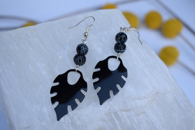 Black enameled leaf and Crackled black agate beads. Mid length leaf and stone earrings