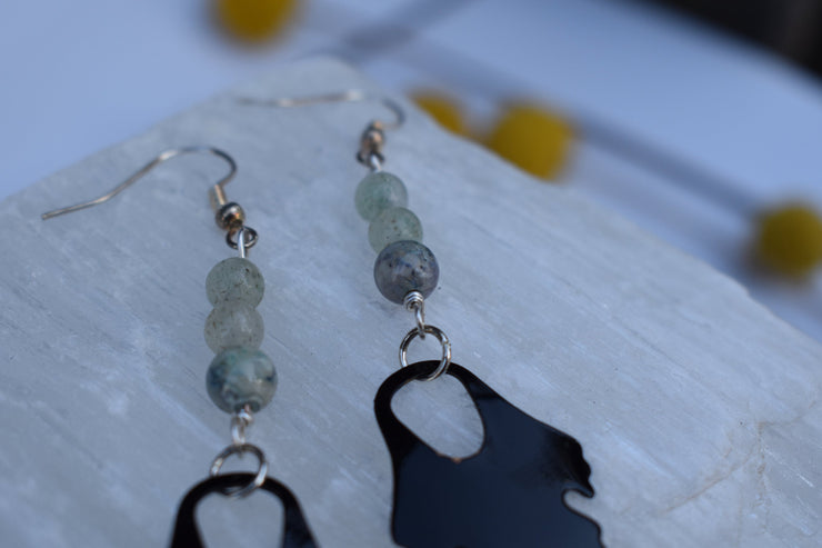 Black enameled leaf and pastel green stone beads. Mid length leaf and stone earrings