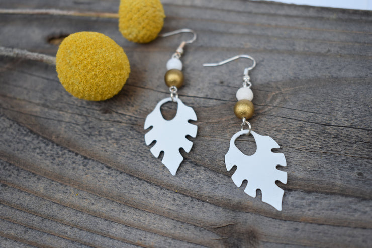 White enameled leaf and gold bead earrings. Mid length leaf and beads earrings