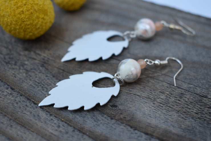 White enameled leaf marbled plastic and peach bead earrings. Mid length leaf and beads earrings