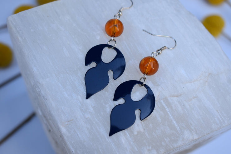 Blue enameled leaf and amber colored earrings. Mid length leaf and bead earrings