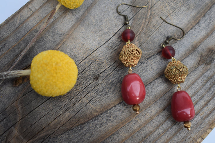 red glass and stone bead and brass filigree statement earrings.