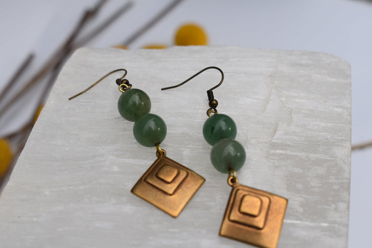 Diamond shaped brass and jade beads
