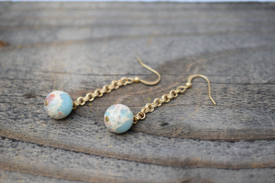 Beautiful aqua blue marbled Aqua Terra beads and antiqued gold chain dangle earrings.