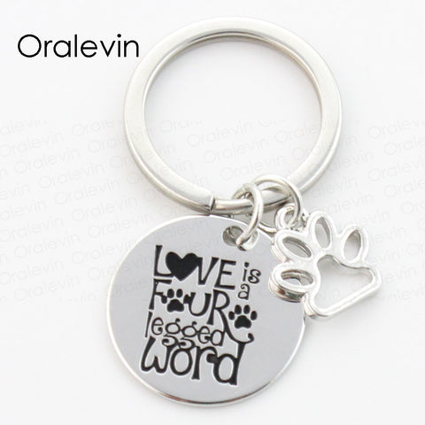 LOVE IS FOUR LEGGED WORD Dog Pawprint Keychain