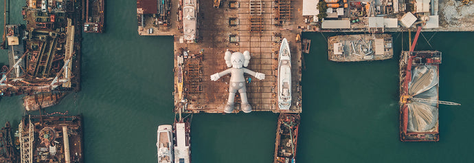 The 37-meter-COMPANION docking in Victoria Harbour - KAWS:HOLIDAY HONG KONG