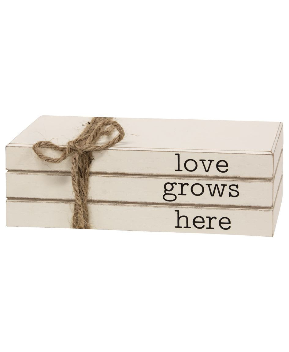 Love Grows Here Stacked Books