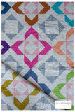 Modern lap quilt. Charmed quilt pattern by Lou Orth