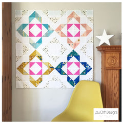 Charmed quilt pattern by Lou Orth. Modern baby quilt