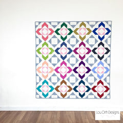 Charmed large lap quilt by Lou Orth. Modern quilt pattern
