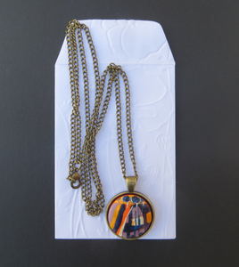 Hand painted pendant in yellow orange purple blue and white