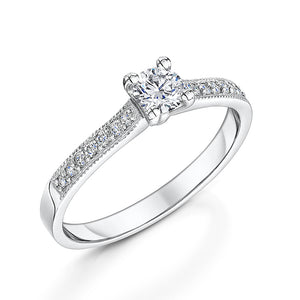Low set Platinum solitaire with diamond shoulders