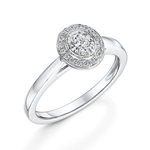 An oval cut, halo style diamond ring