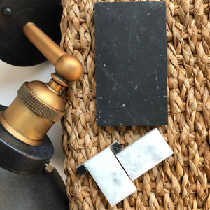 Bathroom Materials for Black and Brass bathroom including light fixture, marble mosaic tile, black cement tile and jute rug