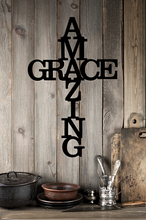 Amazing grace script in the in of a cross modeled on a wood wall