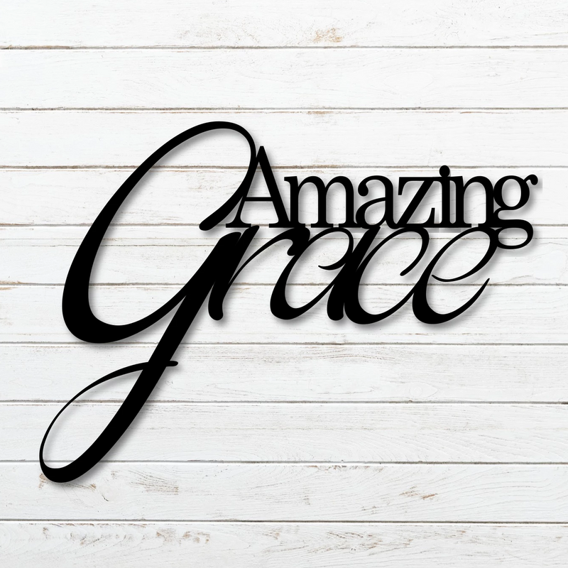 "Script ""Amazing Grace"" sign modeled on brick white wall"