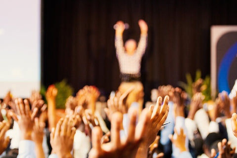 People raising their hands to support each other
