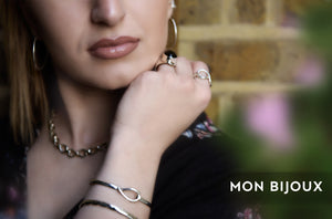 Despina wearing silver fish bangle infinity necklace earrings rings