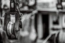 Load image into Gallery viewer, Rusty pulley on a fishing boat