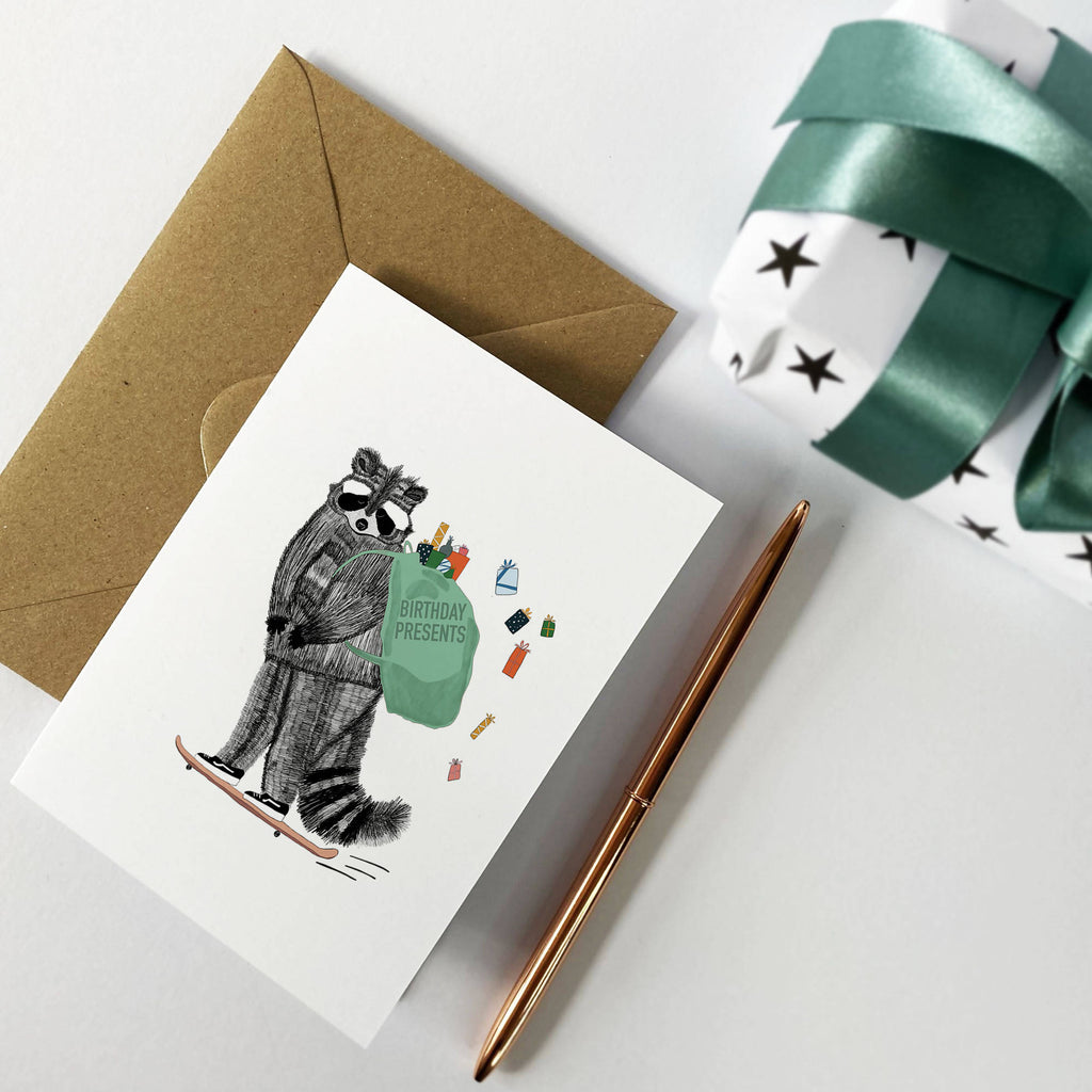 Raccoon Skateboarding Delivering Presents, Raccoon Illustrated Birthday Card, Birthday Greeting Card, Merry Christmas, Present Delivery