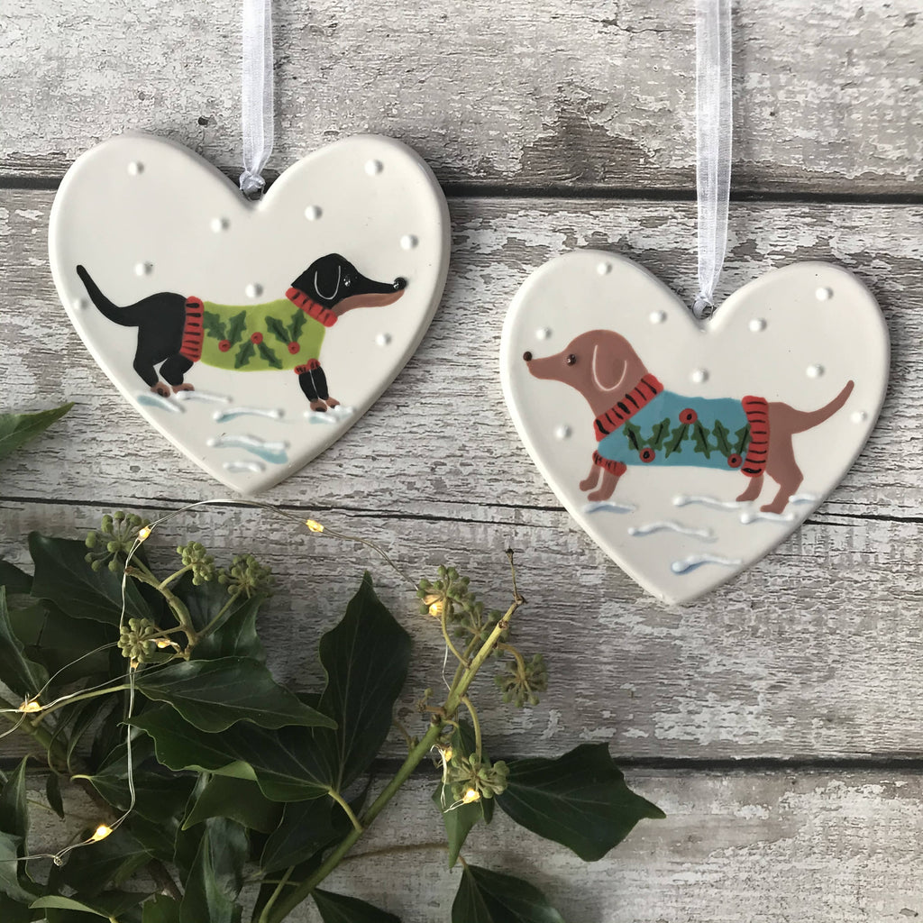 Tan Dachshund / Sausage Dog Wearing A a Green Christmas Jumper Standing In The Snow Hand Painted Christmas Ceramic Heart