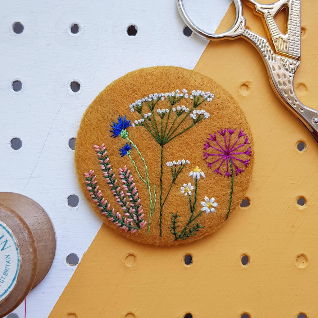 Yellow floral badge