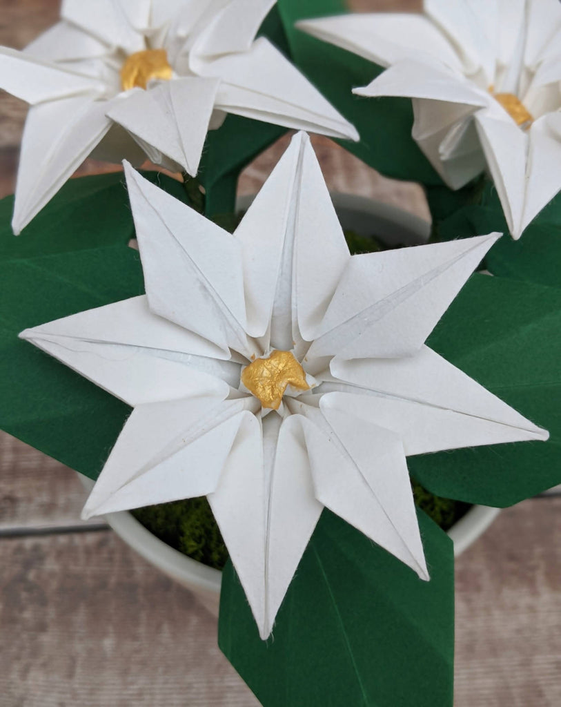 White origami paper plant in ceramic pot