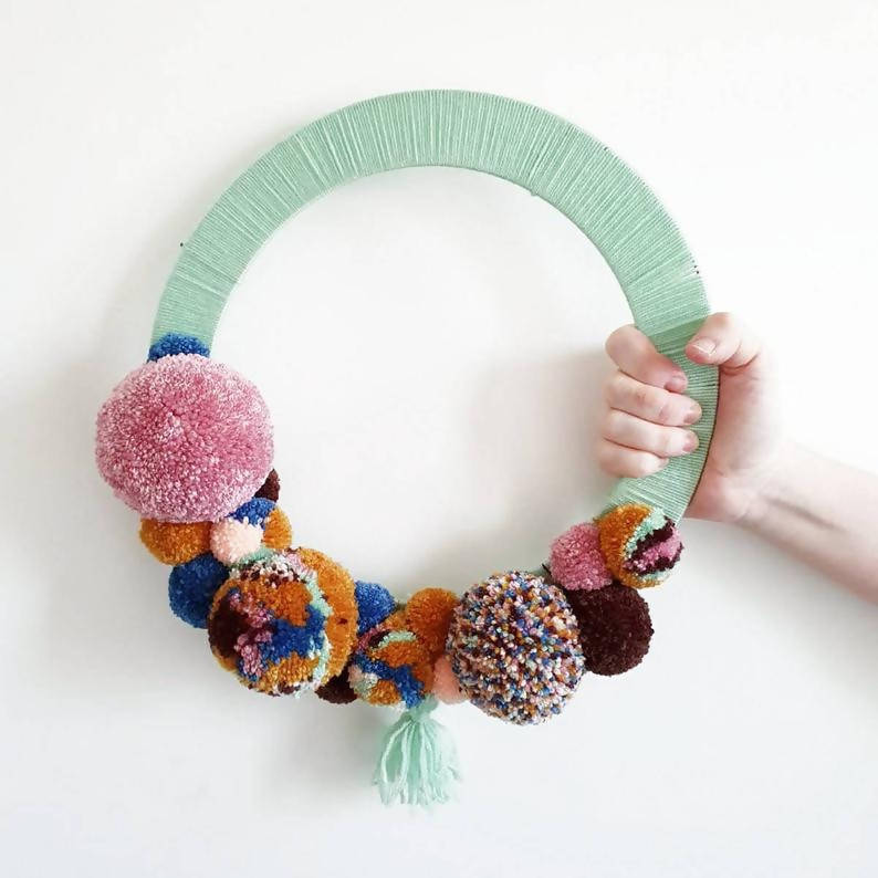 Pom pom wreath/statement wall hanging