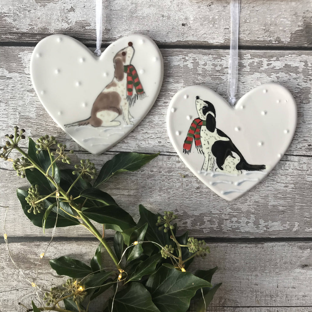 Black And White Spaniel/Cockapoo Wearing A Red And Green Striped Scarf Sitting Down In The Snow Hand Painted Christmas Ceramic Heart