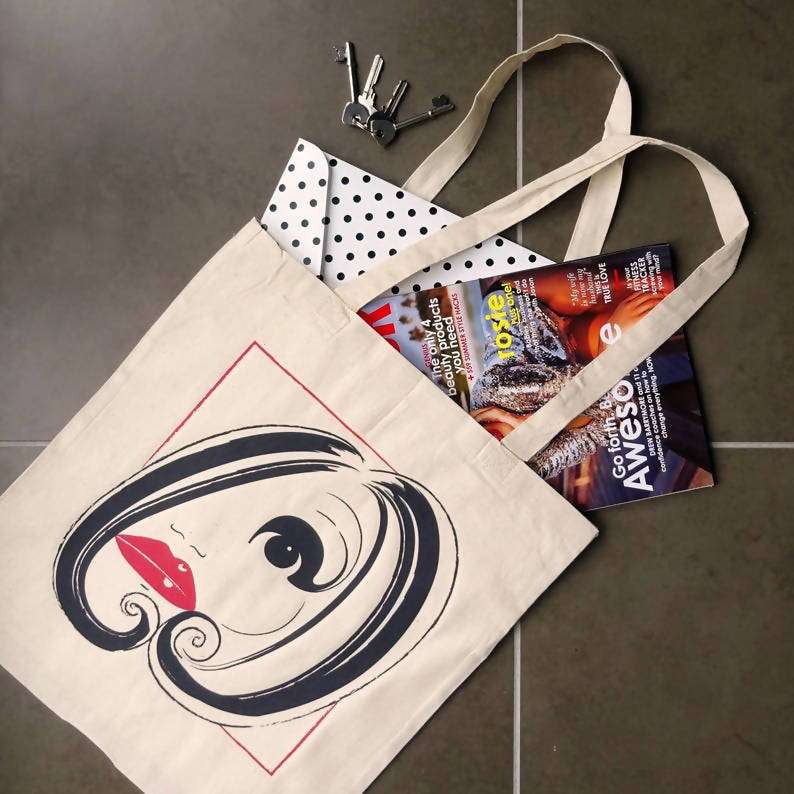 Face illustrated tote bag